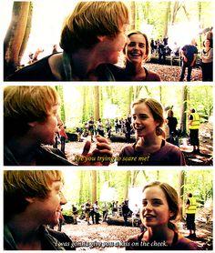 Rupert Grint trying to sneak a kiss to his on-screen sweatheart Emma Watson