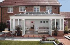 Love the greenhouse type patio...