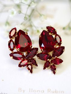Ruby Earrings, Ruby Red Swarovski Cluster Earrings, Bridal Ruby Earrings, Bridesmaids Earrings, Pomegranate Crystal Earrings, Gift for her  Dazzling Cluster Crystal earrings feature a Marquise Pear cut shape crystals set on a secure prong settings. The perfect shade for cocktail parties or to add a touch of color to your wedding ensemble  Petite Delights is an Official SWAROVSKI® Branding Partner Our brand is legally licensed & authorized By Swarovski Company for high quality manufacturin...