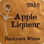 Apple liquer is just one of hundreds of beverages you can use on this custom personalized label with brown paper and drawstring.