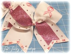 Only 3 left! Get your bow for the pink out game! Breast cancer awareness cheer bows by Two Tiara's Bowtique on Etsy or Facebook group for updates and current information.  Etsy listing at https://www.etsy.com/listing/202800893/pink-out-cheer-bow-for-breast-cancer