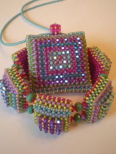 Disco Squares Pendant and Bracelet by Beadwork by Sian, via Flickr