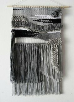 Hand woven wall hanging. This listing can be customized to any color you want! The style and size will remain the same but I can cage the black