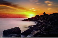 """Picture-A-Day (PAD n.2410) """"Watch and Wait""""  The guy sitting not the rocks was actually a photographer too, so I hope he got some good shots :D prints and more: http://www.dangrabbit.com/photography/pad/02_22_watchandwait  Sunset over Long Island, NY fineart photography"""