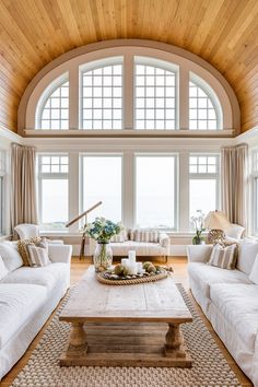 beautiful living room, wooden barrel vaulted ceiling white furniture