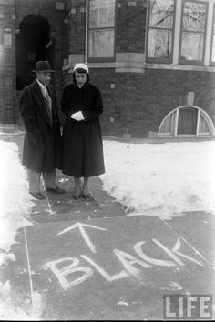 A couple who'd moved into an all-white neighbourhood looks at graffiti scrawled in front of their home, Chicago, photo by Gordon Parks Gordon Parks, Fosse Commune, Couple Noir, Foto Real, Black Couples, African American History, Native American, Before Us, The Villain