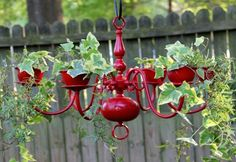 A unique way to use an old chandelier, this design is the perfect way to add that elegant touch to your backyard or garden. As shown above, hanging plants and vines look great with this particular design.