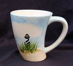 Hand painted ceramic mug with the Cape Hatteras Lighthouse. Perfect for any hot or cold beverage!