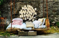 Rather than putting up some porch swings, why not install a comfy, inviting floating bed -- either hanging from trees or under a porch.  Make out of pallets, frame out?
