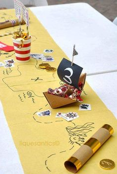 Table runner with center pieces. Treasure map table runner with gold coins. Would be ideal for a pirate themed birthday party
