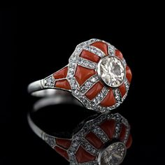 Buff-Cut Ox-Blood Coral and Diamond Set Platinum Channels in an Art Deco Ring. Image courtesy of Lang Antiques.