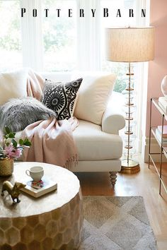 Add a touch of glam to your living room! Opt for a hammered metal coffee table, faux fur pillows and tones of blush pink for an easy home update.