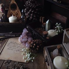 To capture The mornings spirit Delicately revealing A world of art. Preparing for tomorrow's etsy update with all new altar kits. Featuring spirit quartz, cabinet cards, candles, herb vials, bones, crystal clusters and crystal grids. All included in antique boxes found on this weeks thrift store visits.