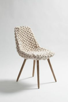 I love this knitted Eames chair.  Eames chairs always have such fun textures, another art-like quality.  I wonder why the Eames' decided on chairs.  What was it about chairs that drew their fancy?