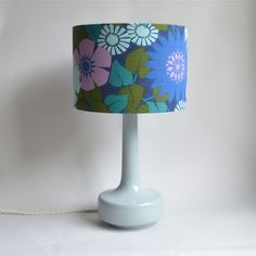 http://www.wintersmoon.co.uk/products/copy-of-bell-bottom-grey-table-lamp-with-vintage-flowers-leaves-shade