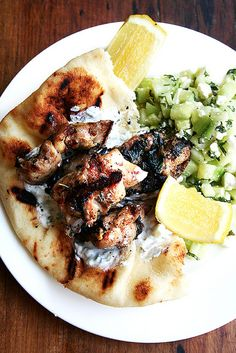 Chicken Souvlaki with Tzatziki and Cucumber salad - SO. GOOD. Chicken is juicy and tasty and the sauce, oh, the sauce...also excellent with lamb.