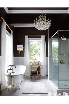 From crystal chandeliers to mirrored vanities, these bathrooms are fit for a movie star.