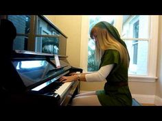 Musical talent + cosplay = PROFIT. Lara plays a Zelda N64/OoT medley as Link on piano. :)
