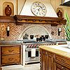 Old-World Charm. Several varieties of marble and limestone on the backsplash, floor, and counters help give this kitchen its inviting old-world style. The backsplash also features variations in scale for added interest, showcasing a mosaic tile niche set within larger square tiles. All of the stone is honed, and some is even distressed, to emphasize the kitchen's aged character.