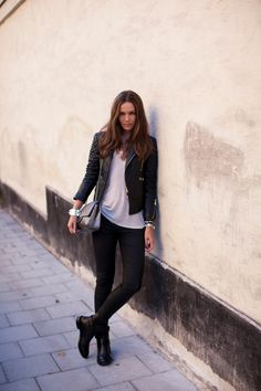 jacket from Balenciaga, bag from Chanel, Zara jeans, boots from Celine and a T by Alexander Wang tee.