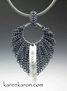 Tiny Scale Bat Wing Chainmaille Pendant. Anodized and Bright Aluminum on Rubber Neck Cord. http://www.karenkaron.com/designer.html