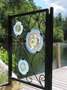 Garden gate: wrought iron frame and scrolls by Steven Hayden; Glass rondels by Alex Kalish.