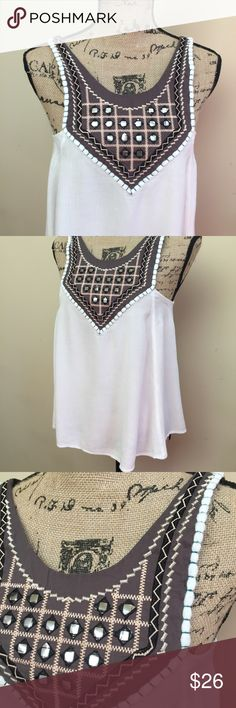 Umgee Top So pretty, Umgee Tunic, embellished neck line, EUC, light airy fabric, bust-15 inches, length-25 inches, pair with shorts or jeans for a cute boho look Umgee Tops Tunics