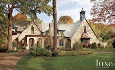 nice Stone Exterior with Shingle-Style Roof