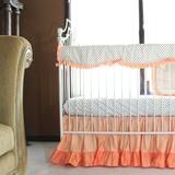 In stock and ships in 2 days. Most popular coral baby girl bedding in gorgeous sunset coral and papaya coral shades highlighted with metallic gold dots on white. This entire set is made with 100% soft cotton in a satin weave (shiny soft finish). 2pc set includes sheet and skirt. 3 pc set includes the reversible rail cover. Reversible rail cover and reversible comforter allow you to create4 different looks with this one set. Add extra crib sheets - you can also buy a solid coralcrib sheet…