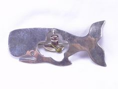 SoVintageous is offering this unique Anne Harvey Taxco Mexican sterling silver brooch depicting a man in a rowing boat floating freely in the belly of a whale, a la Jonah & the Whale.  A brass oar
