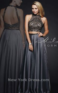 Be coy in a mysterious gown from Milano Formals E1940. A high neckline is  spangled fa8131226