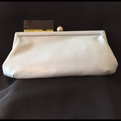 """Pale Blue Faux Leather Top-Frame Clutch Palest pale blue incredibly soft faux leather exterior (reminiscent of deer skin) gives way to a surprise hot pink satin interior. S-Link strap allows for a 22"""" drop from the shoulder or tuck away. Interior has a 5.5"""" zip pocket. Secure flip lock clasp. Sasha Bags Clutches & Wristlets"""