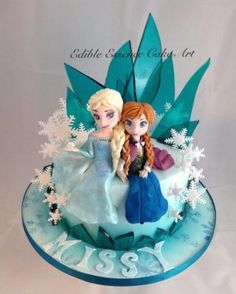 hi this is my disneys frozen cake I absolutely love this one has to be my favourite so far I used sugar glass for the first time and also snowflake stencils and luster on the iced cake to give a bit more depth, elsa and anna are made from. Frozen Birthday Party, Frozen Party Cake, Disney Frozen Cake, Disney Cakes, Party Cakes, Bolo Frozen, Torte Frozen, Bolo Elsa, Anna Cake