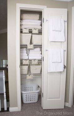 Guest room linen closet - like the idea of a laundry basket in there for guests to put their dirty linens in and towel bars on the inside of the door