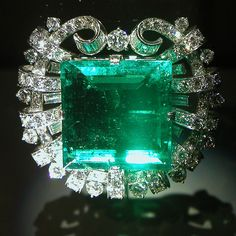 The Hooker Emerald Brooch.  The emerald is a 75.47- carat, square, emerald-cut gemstone in a deep grass-green color from the mines of Columbia.  It is surrounded by 109 smaller round brilliant-cut diamonds set in Platinum.  Smithsonian's National Museum of Natural History.  (=)