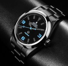 Fragment design's Hiroshi Fujiwara has teamed up with Rolex and Bamford Watch Department on a new Oyster Perpetual Explorer watch.    The Oyster Perpetual Explorer gets the blacked out treatment with blue detailing seen on the 3, 6 and 9 hour markers, the second hand and the fragment logo.