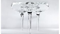 Stunning Ice Sculpture Table Will Never Melt Away... made from long-lasting clear acrylic by architect Zaha Hadid.