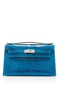 This Kelly Pochette bag by   Hermès   curated by   Heritage Auctions   is  rendered in Blue Izmir Alligator and is extremely rare. 16da08df05