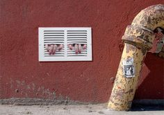 Controversial and memorable street art by Dan Witz features realistic images of people trapped behind fake ventilation grates.    The artist places these photo-based, heavily painted stickers on the walls and buildings around New York and other cities.