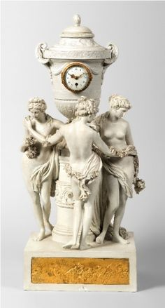 A bisque porcelain mantel clock depicting the Three Graces. French, late 19th century.