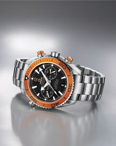 FANCY SALE: Follow us and repin and win  Omega Seamaster Planet Ocean Chrono. There's just something unique and appealing about the orange bezel.  (Click on photo to see more ...)