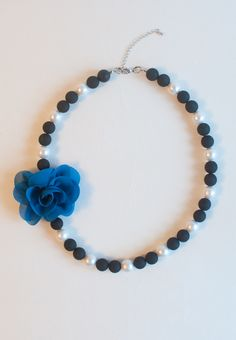"""This is handcrafted necklace making with cotton pearls, resin beads and silk. Ideal accessory for elegant ladies' everyday outfits.  Length: 20.5"""" Extender: 2 1/2"""" Weight: 43g Lobster clasp closure Silver / Silk / Cotton / Resin"""