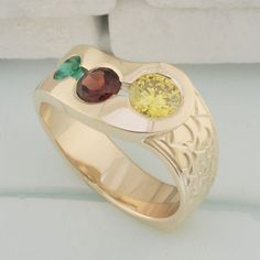 14kt yellow gold mothers ring Engraved ring with bezel-set yellow diamond, garnet and emerald