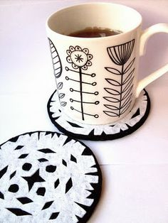 i know this is a tutorial for snowflake coasters, but....I really like this mug and figure that I could do this with a white mug, a sharpie, and a hot oven.