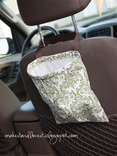 DIY: A little bag to attach to the back of your head rest. That is always propped open. And it's fabric, so if you happen to get something sticky in there…..pop it in the washing machine.