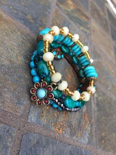 A personal favorite from my Etsy shop https://www.etsy.com/listing/245730878/turquoise-memory-wire-bracelet-brown-snd
