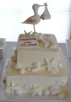 cake for beach themed all white baby shower - with sandpiper topper. by Dessert Deli, Buffalo, NY