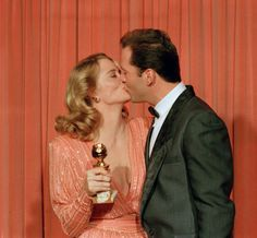 Moonlighting co-stars Cybill Shepherd and Bruce Willis kiss for photographers after they both won Golden Globe awards for their roles as private detectives. Bruce Willis, Tv Actors, Actors & Actresses, Moonlighting Tv Show, Hollywood Or Bust, Cybill Shepherd, Best Tv Series Ever, True Detective, Old Tv Shows