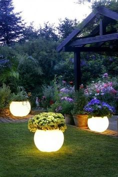 Outdoor planters coated with  glow-in-the-dark paint create instant night lighting in this backyard escape.