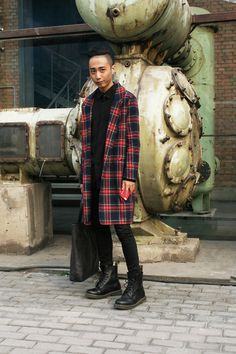 As part of the growing importance of pared back dressing in Asia, this simple head-to-toe outfit subtly references punk with the addition of classic red checked outerwear at China Fashion Week.